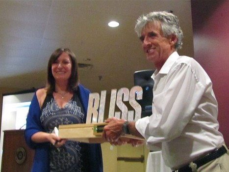 "Frank Shorter presents Lorraine Moller with the ""Bliss"" award at the Boulder Sports Hall of Fame"