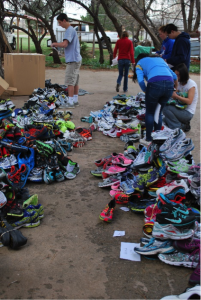 One World Running donates shoes to runners during its service trips to Belize and Honduras and around the world