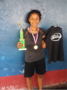 One World Running - girl finisher with trophy